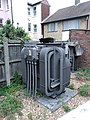 Cat napping on substation Portsmouth UK 2018.jpg