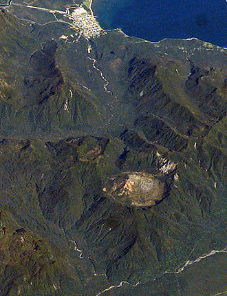 Chaitén (volcano) - 2003 photograph from the International Space Station. The caldera is the circular feature visible in the lower part of the image. The town of Chaitén is to the top.