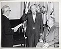 Charles A. Birmingham being sworn in as member of Boston Metropolitan District by City Clerk Walter J. Malloy with Mayor John F. Collins (13562548445).jpg