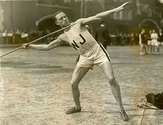 Charles Fremont West - West throwing javelin.
