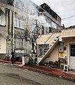 Child walks past smoking chimney Samsun Turkey.jpg