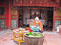 Chinese god fishing statue in Tay Kak Sie Temple.jpg