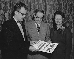 David Levine (politician) - Levine (center) in 1958 in his capacity as president of the Civil Service League, flanked by League treasurer Ben Merrill and Mrs. Merrill.