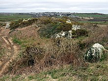 View of Clegyr Boia. The eastern end of the hillfort/rock mound looking over to the city of St Davids clustered around the cathedral at its core, the lowest point.
