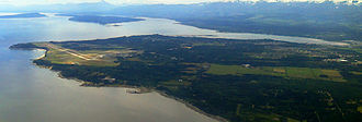 Comox, British Columbia - The peninsula on which Comox sits, seen here from the north, is surrounded on three sides by water: the Strait of Georgia to the east, Comox Bay to the south and the Courtenay River Estuary to the west.