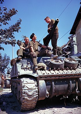 Canadian crew of a Sherman tank, south of Vaucelles, France, during the Battle of Normandy in June 1944 Crew of a Sherman-tank south of Vaucelles.jpg