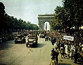Crowds of French patriots line the Champs Elysees-edit.jpg