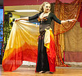 Dancer wrapped in a colorful veil (8015759367).jpg