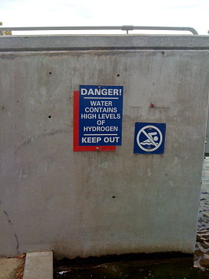 Louisville Waterfront Park - Danger (hoax) sign at Waterfront Park fountain