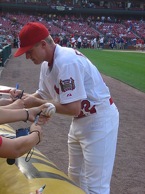 David Eckstein - Eckstein signing autographs before a May 30th game against the Houston Astros in 2006 as a member of the Cardinals.