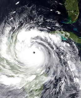 A view of Hurricane Devan from Space on August 20, 2007. Dean is a mature and well-developed hurricane, with a pronounced eye and well-defined banding features. The storm is located south of Cuba and east of the Yucatan Peninsula.