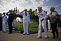 Delton Walling, a Pearl Harbor survivor, salutes as he walks through an honor cordon during a ceremony marking the 71st anniversary of the attack on Pearl Harbor in Honolulu 121207-F-MQ656-468.jpg