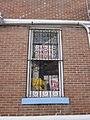 Deutsches Haus NOLA exterior Window signs.JPG