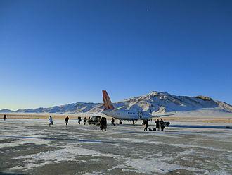 Zavkhan Province - Passengers boarding a propeller plane to Ulaanbaatar at Donoi Airport (Uliastai) Zavkhan, Mongolia.