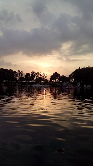 Doodh Talai Lake - Picture of Doodh Talai Lake, showing an evening sunset, taken from a boat inside a boat in the lake.