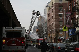 2014 East Harlem gas explosion - Firefighters battling the flames.