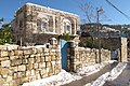 Ein Kerem traditional stone building' after snow - photo Ron Havilio.JPG