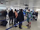 Passengers at Linate Airport in Milan have their temperatures taken