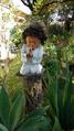 Estatueta no Jardim Mandala.png