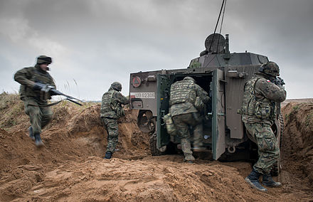 Crew of a KTO Rosomak armored personnel carrier during a NATO exercise at the Military Training Area near Drawsko Pomorskie Ex STEADFAST JAZZ (10710349373).jpg