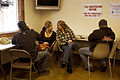 FEMA - 39981 - Residents work on their FEMA forms at a DRC in Washington.jpg