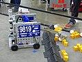 FIRST Championship Detroit 2019 – Bot picking up minerals 30.jpg