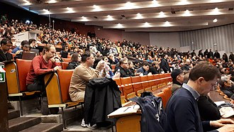 A characteristically crowded main session at FOSDEM