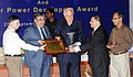 "Farooq Abdullah gave away the ""Certificate of Appreciation"" and Trophies to Solar Power Developers for their best performance, at a function, in New Delhi on September 25, 2013.jpg"