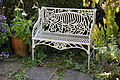 Feeringbury Manor garden cast iron bench, Feering Essex England.jpg