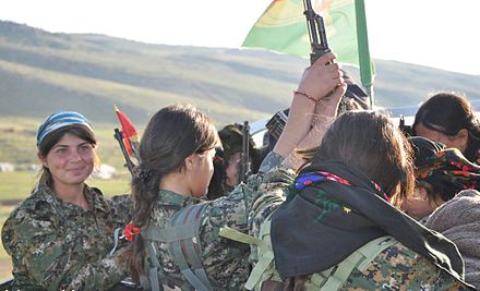 YJE are women fighters trained by the Kurdish Workers Party guerillas to defend themselves against Islamist extremists. Female Yezidi resistance fighters - YJE.jpg