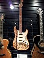 Fender Carved Floral Stratocaster (2004), Taylor Liberty Tree Guitar (2002), Museum of Making Music.jpg