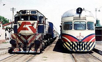 Domingo Faustino Sarmiento Railway - Old Diesel locomotive and DMU in Marcos Paz, Buenos Aires in Ferrocarriles Argentinos livery prior to privatisation.