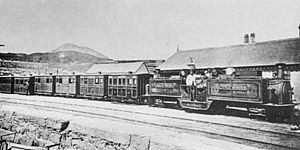 Robert Francis Fairlie - Little Wonder with train of four-wheeled passenger carriages at Portmadoc harbour station on the Festiniog Railway c1870.