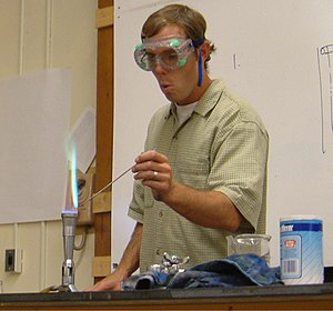 Flame test - The flame test carried out on a copper halide. The characteristic bluish-green color of the flame is due to the copper.
