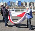 Folding the Jersey flag 2011 3.jpg