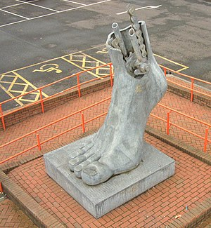 Flint, Flintshire - Footplate sculpture at Flint railway station, designed by Brian Fell.