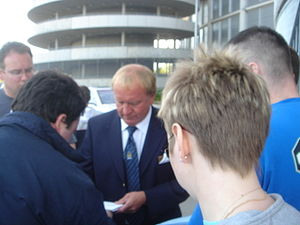Francis Lee - Lee (centre) signing an autograph