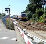 Freight train approaching Rhoose level crossing - geograph.org.uk - 3351915.jpg