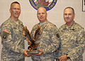 From left, U.S. Army Col. Gregory Thingvold, Lt. Col. Chad Sackett and Maj. James Shirk pose for a photograph during an award ceremony at St. Paul, Minn., July 8, 2011 110708-A-DE783-005.jpg