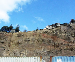 2016 Christchurch earthquake - The cliffs of Peacock's Gallop were separated from the road to Sumner by shipping containers stacked two high (photo 2012).