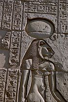 The warrior goddess Sekhmet, shown with her sun disk and cobra crown