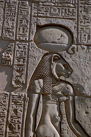 The warrior goddess Sekhmet, shown with her su...