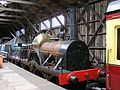 GWR 'Firefly' 2-2-2- replica loco built 2002, in transfer shed, GWS Didcot , January 2008 P1050096 (9940112604).jpg
