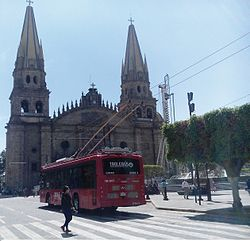 Guadalajara cathedral and trolley.jpg