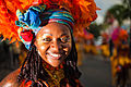 Guadeloupe winter carnival, Pointe-à-Pitre parade. A young woman, performer wearing traditional carnival head-dress(close up outdoor portrait).jpg