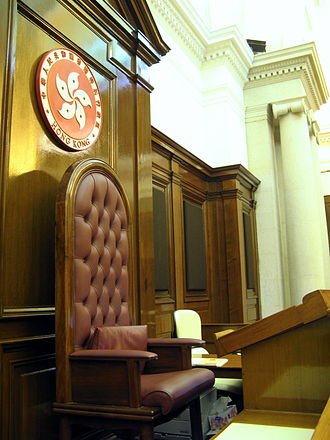 Emblem of Hong Kong - Current emblem (1997-present), shown behind the seat of the President of the Legislative Council.