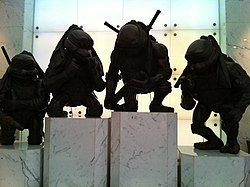 HK TST 100 Canton Road TheToyHouse lift lobby exhibits Playmates Toys 隱者龜 Turtles bronze sculptures standing Dec-2012.JPG