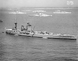 Photo showing a battleship in the foreground and more battleships and cruisers in the background