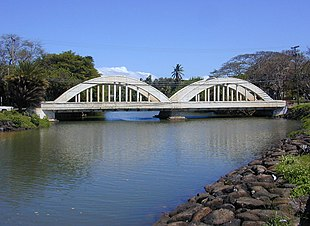 """Historic twin-span """"Rainbow Bridge"""" over the <a href=""""http://search.lycos.com/web/?_z=0&q=%22Anahulu%20River%22"""">Anahulu River</a> marks the north end entrance to old Haleʻiwa Town"""