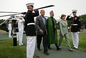 President Hamid Karzai's August 2007 visit to the United States, where he was met by George and Laura Bush at Camp David in Maryland.